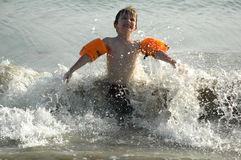 Boy splashing in the waves. Portrait of boy jumping in the waves, nikon D70 Royalty Free Stock Image