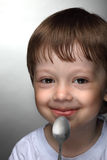 Boy with spoon Royalty Free Stock Photos