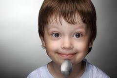 Boy with spoon stock photos