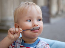 Boy with spoon Stock Image