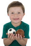 Boy with sport balls. Boy holding several sports balls royalty free stock image