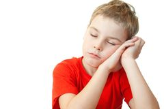 Boy in sports shirt sleep on his hands. Sweet little boy in red sports shirt sleep on his hands Stock Photography
