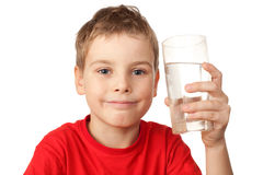 Boy in sports shirt with water glass in hand Royalty Free Stock Photography