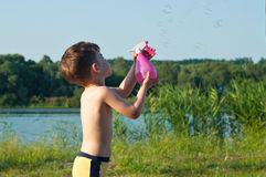 Boy with spray bottle Royalty Free Stock Photography