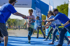 Boy sprayed with powder at Color Run Bucharest Royalty Free Stock Images