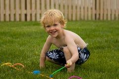 Boy spraying sprinkler Royalty Free Stock Photos