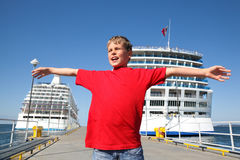 Boy spread hands against background two ships Royalty Free Stock Photos