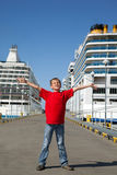 Boy spread hands against background two ships Stock Images