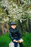 Boy on a walk in the garden in the spring stock photo