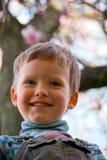 Boy in spring park Stock Photo