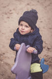 Boy on spring swing Royalty Free Stock Images
