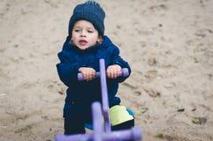 Boy on spring swing Stock Photo