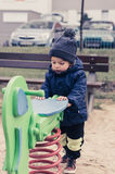 Boy by spring swing Stock Photography