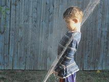 Boy in the Sprinkler Stock Photos