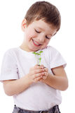 Boy with sprouts in hands Royalty Free Stock Photo