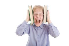 Boy squeeze head by two books and scream Stock Photography