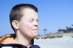 Boy squinting eyes. Royalty Free Stock Photos