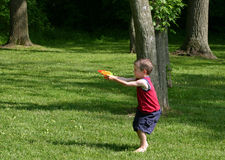 Boy Squirting Squirt Guns Stock Photos