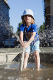 Boy Squirting Water Royalty Free Stock Image