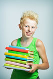 Boy with a stack of books stock photo