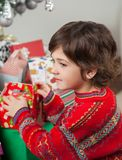 Boy Stacking Christmas Gifts Royalty Free Stock Photography