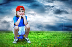 Boy on the stadium. Happiness young boy on the field of stadium with light Stock Images