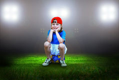 Boy on the stadium. Happiness young boy on the field of stadium with light Stock Photos