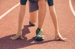 The boy in the stadium. Cardio for health. Sports lifestyle. Stock Image