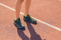 The boy in the stadium. Cardio for health. Sports lifestyle. Stock Photography