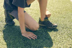 The boy in the stadium. Cardio for health. Sports lifestyle. Stock Photos
