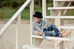Boy on the stairs Royalty Free Stock Photography