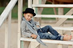 Boy on the stairs Royalty Free Stock Photos