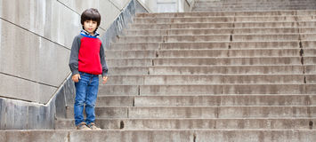 Boy on the stairs Stock Image
