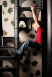 Boy on stairs Stock Photography