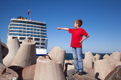 Boy stand on concrete blocks shows up Stock Photography