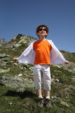 Boy stand on mountain slop Royalty Free Stock Photography