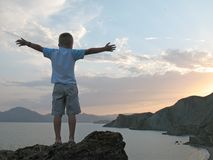 Boy Stand On Mountain Top With Hands Up Stock Photography