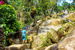 Boy stand on stair near Waterfall in Koh Samui Royalty Free Stock Photo