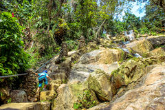 Boy stand on stair near Waterfall in Koh Samui Royalty Free Stock Photos