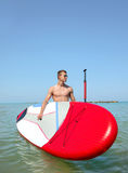 Boy on stand up paddle Stock Photos