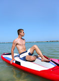 Boy on stand up paddle Stock Image