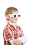 Boy standing in 3d glasses pointing Royalty Free Stock Images