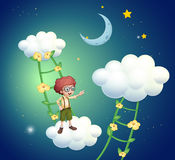 A boy standing above the clouds Royalty Free Stock Images