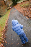 Boy standing alone. Boy standing looking alone on a path Royalty Free Stock Photo