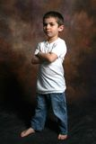 Boy Standing with arms folded Stock Images