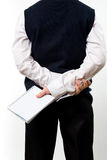 Boy standing backwards with the notepad in hand Stock Images