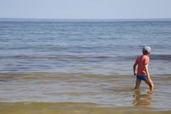 A boy is standing in the Baltic Sea stock photos