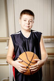 Boy standing with basketball closeup Stock Image