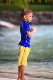 Boy standing on the beach Stock Photo