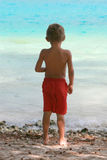 Boy standing on beach Stock Photography